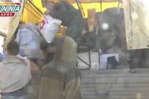 Видеоотчет по доставке гуманитарной помощи и снаряжения ополчению Луганска
