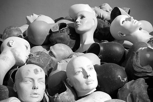 Mannequins heads, black and white.